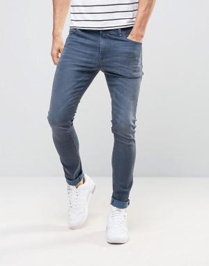 Дымчато-синие супероблегающие джинсы ASOS DESIGN. Цвет: синий