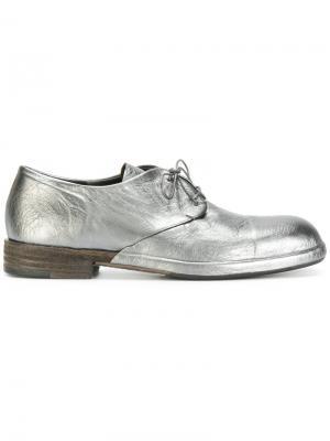 Металлические туфли на шнуровке Del Carlo. Цвет: золотистый