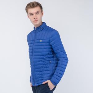 Куртка Легкий пуховик Lacoste. Цвет: синий