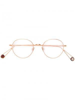Классические очки в круглой оправе Ahlem. Цвет: золотистый