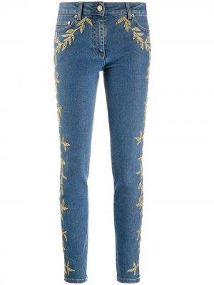 Декорированные джинсы скинни Moschino. Цвет: синий