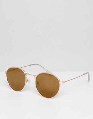 Круглые солнцезащитные очки с оправой цвета розового золота River Isla Island. Цвет: золотой