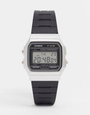 Электронные часы в стиле унисекс с черным силиконовым ремешком и серебристым циферблатом F91WM-7A-Черный Casio