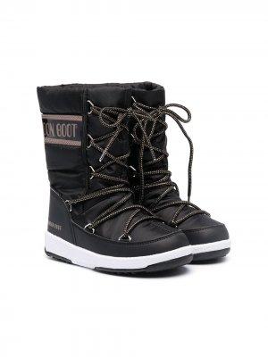 Дутые сапоги на шнуровке Moon Boot Kids. Цвет: черный