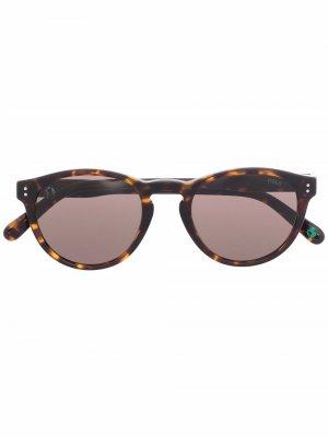 Солнцезащитные очки в круглой оправе Polo Ralph Lauren. Цвет: коричневый