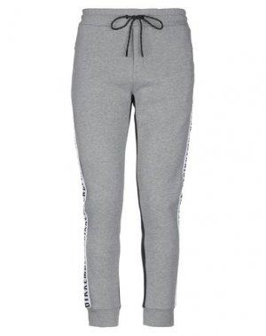 Повседневные брюки BIKKEMBERGS. Цвет: серый