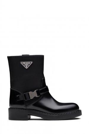 Комбинированные ботинки черного цвета Prada. Цвет: черный