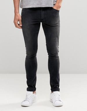 Выбеленные черные супероблегающие джинсы ASOS DESIGN. Цвет: черный