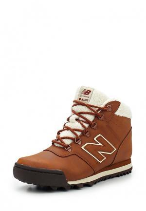 Ботинки New Balance WL701. Цвет: коричневый