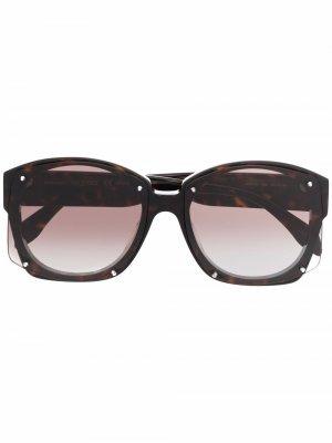 Солнцезащитные очки черепаховой расцветки Alexander McQueen. Цвет: золотистый