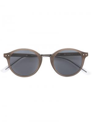 Солнцезащитные очки с круглой оправой Bottega Veneta Eyewear. Цвет: серый