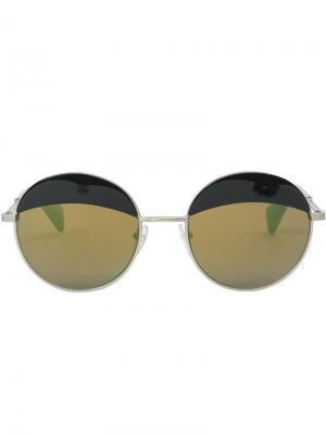Солнцезащитные очки в круглой оправе Yohji Yamamoto. Цвет: металлический